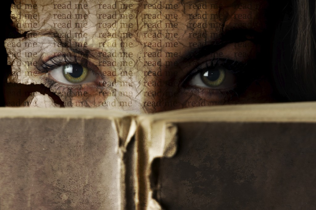 Conceptual mystery portrait of woman with old Bible book